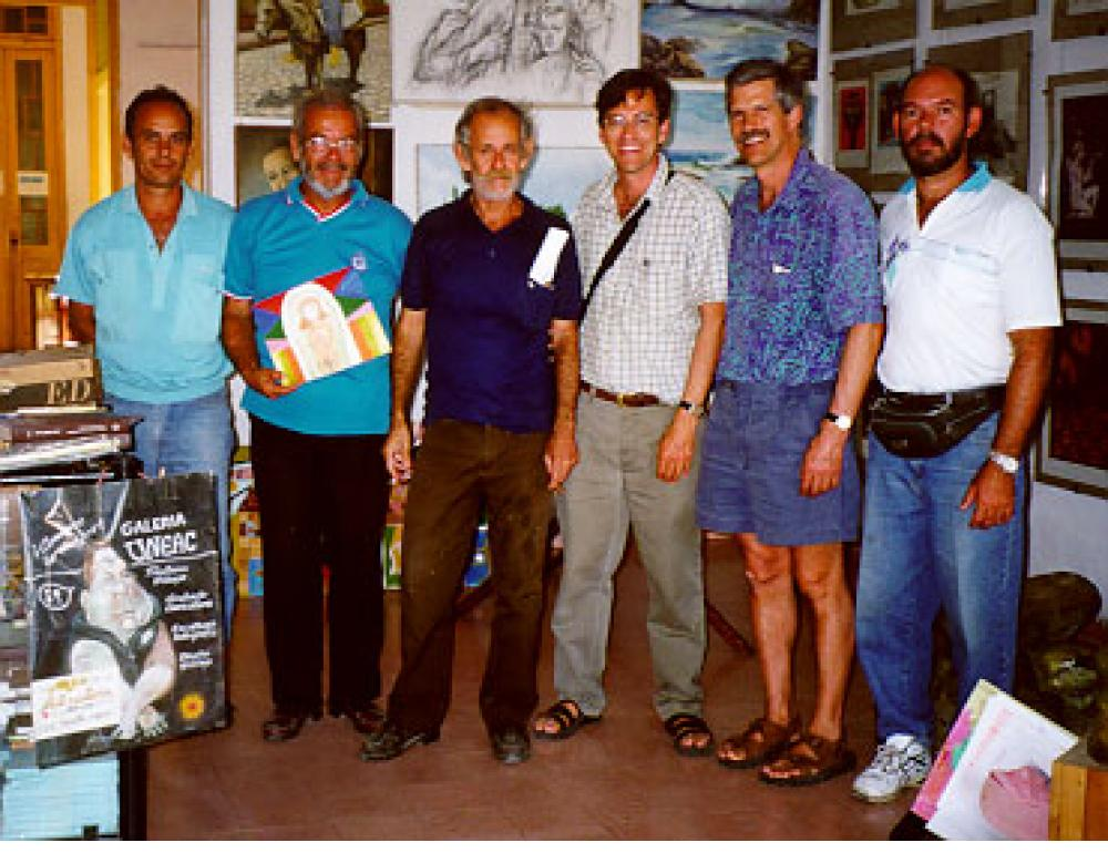 "Cienfuegos ""auto-didacto"" (self-taught) painters, with visitors (left to right) - José Basulto, M. Ferrer, Wayacon, Tony Fisher, Jonathan Fisher, Fito, March, 2000."