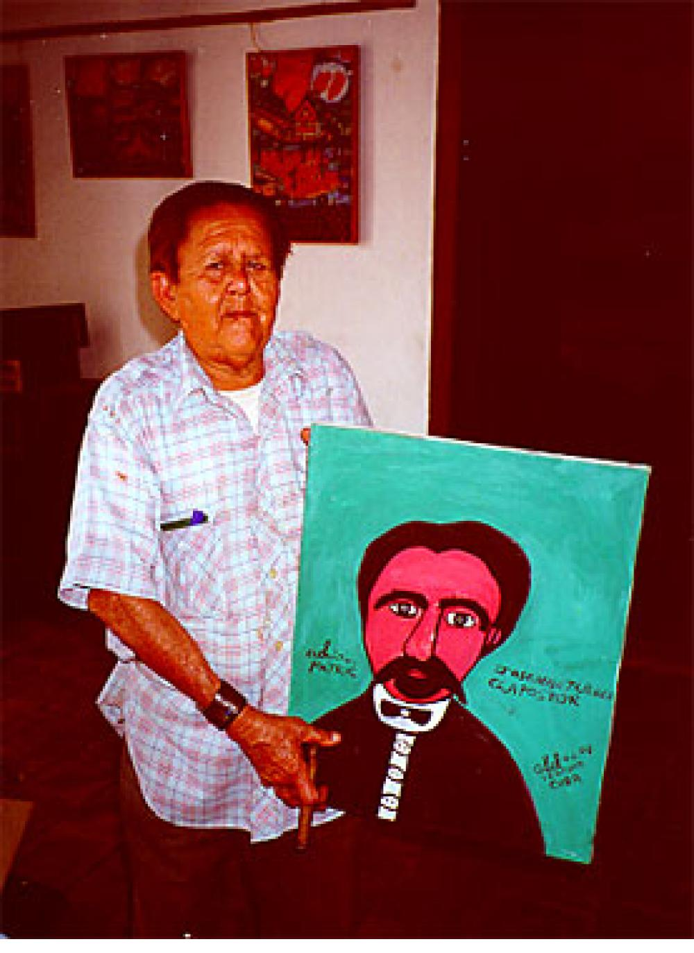 Abel Perez Mainegra with cigar and painting of Jose Marti. Trinidad, Cuba, 2000.