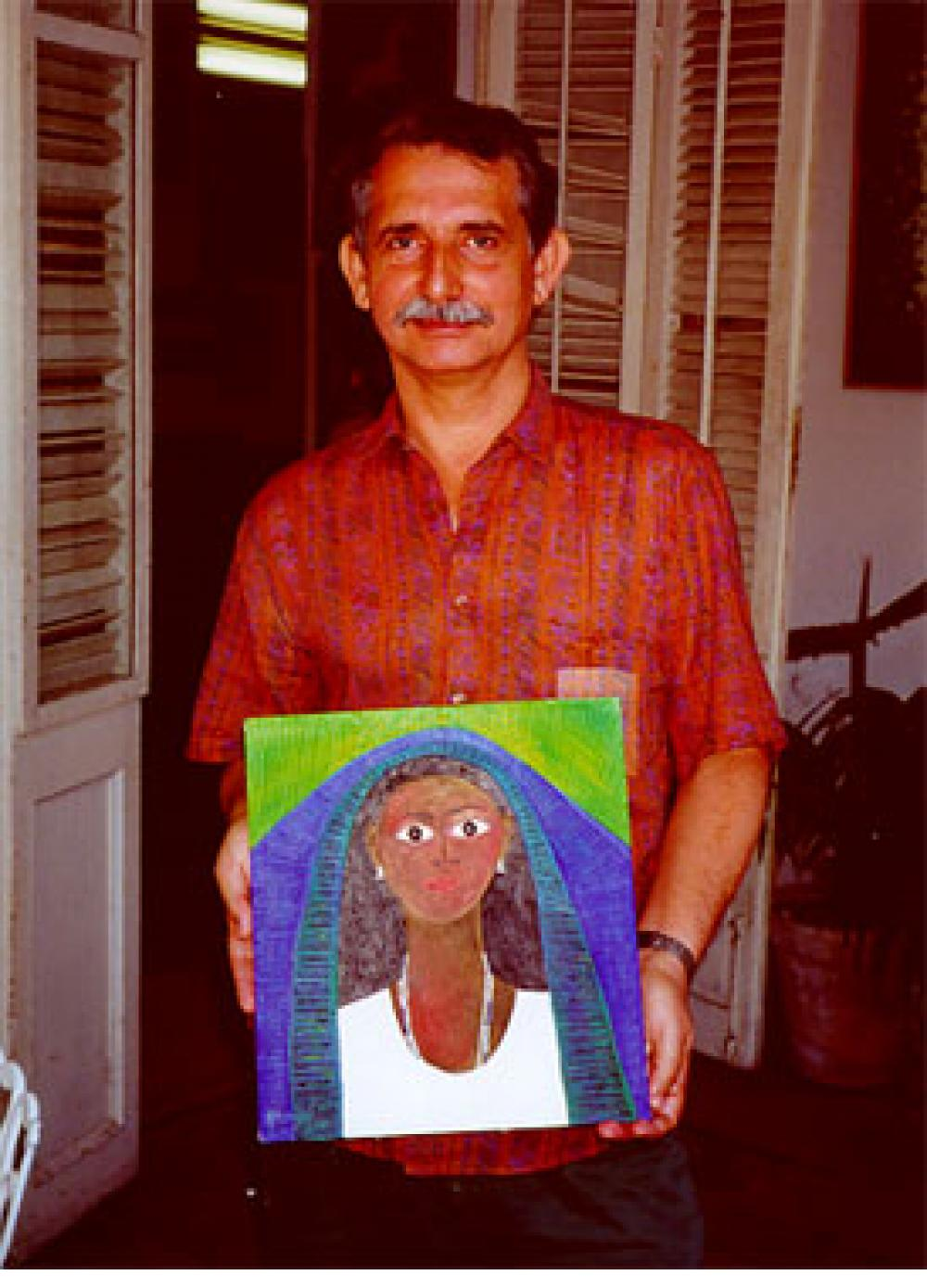 "José Garcia Montebravo with his painting ""Imagen en Azul (Yemaya)"", in his Cienfuegos studio, 2000."
