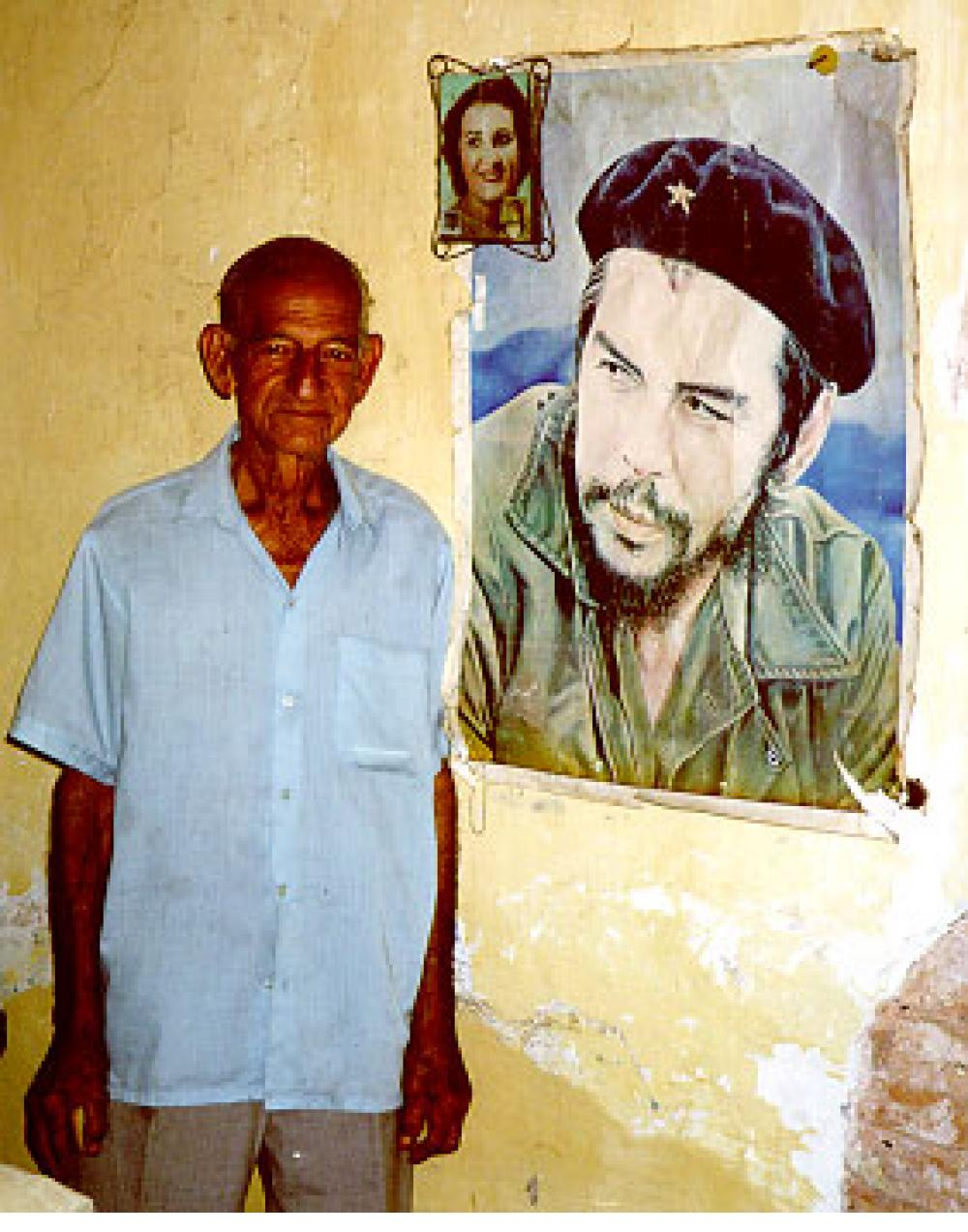 Veteran of the revolution - in Trinidad, Cuba, with pictures of his wife and Ché.
