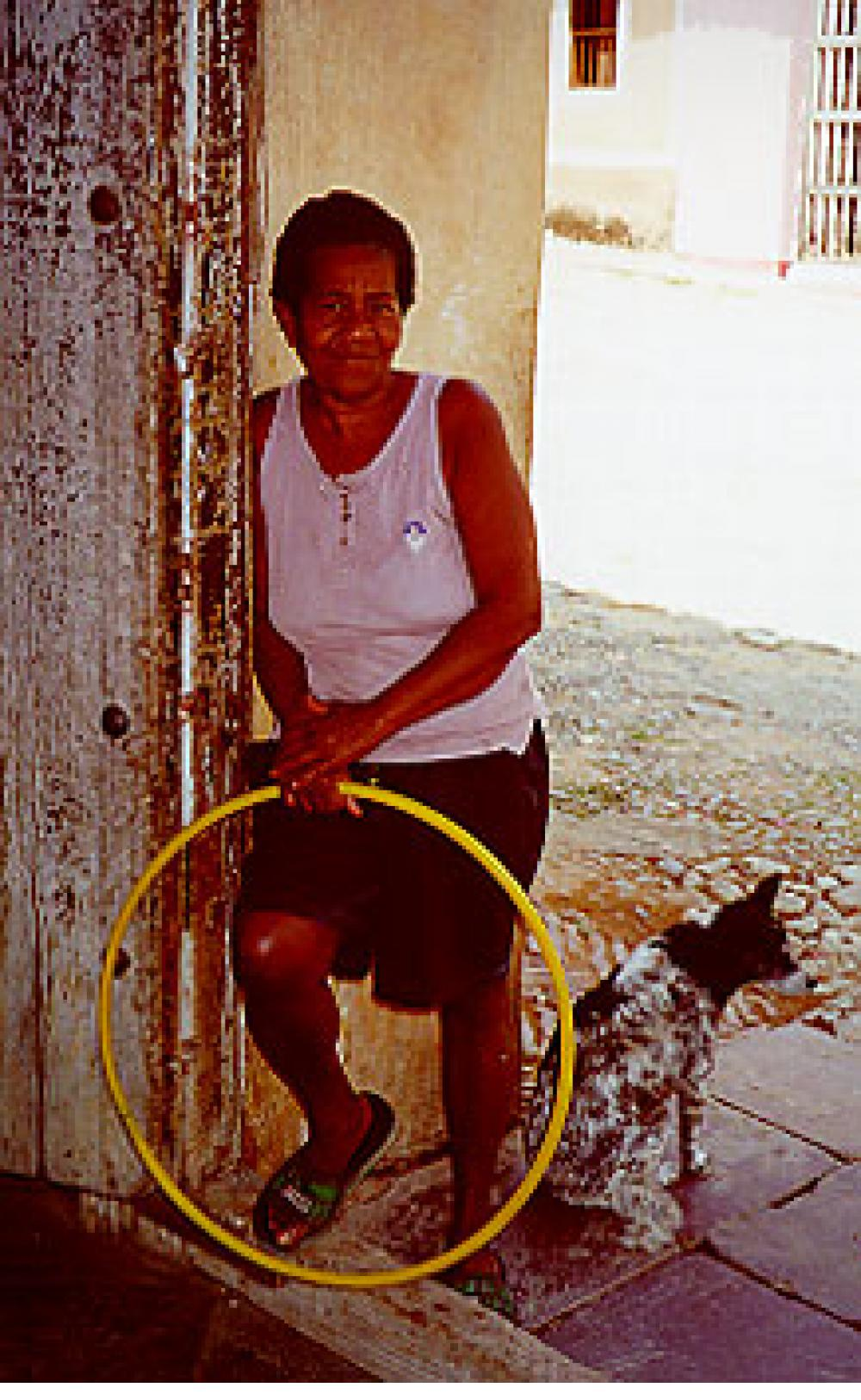 A woman welcomes us to her home in Trinidad, Cuba.