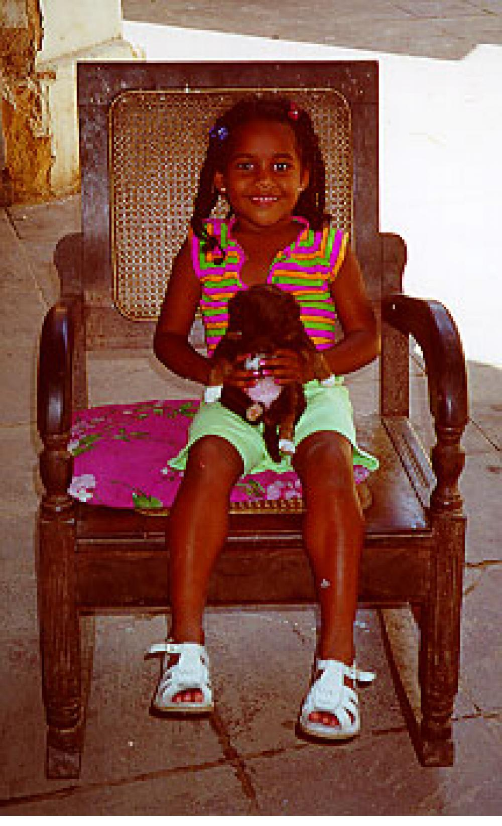 Girl with puppy. Trinidad, Cuba.
