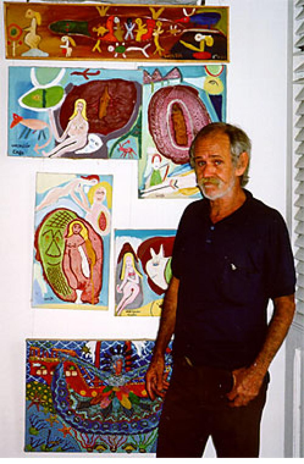 Wayacon (Julian Espinosa) with some of his paintings. Cienfuegos, Cuba, 2000.