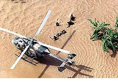 Helicopter rescue in Mozambique  (photo from The Guardian (UK), March, 2000).