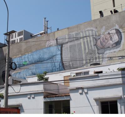 This man was stretched out on a second floor wall in downtown Lima.