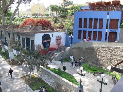 Mural by Jade Rivera dramatically situated on a stairway into the barranco of the Barranco neighborhood.
