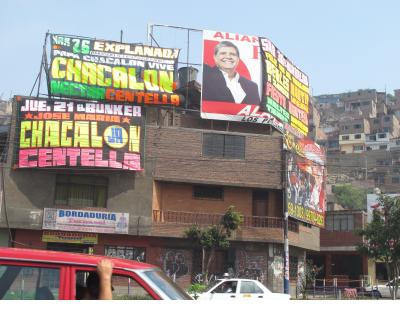 In this neighborhood near Claudio Jimenez's studio the dayglo lettering of the music posters blotted out even the political advertisements.