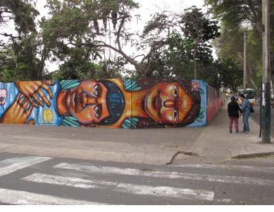 A wall of faces in Barranco.