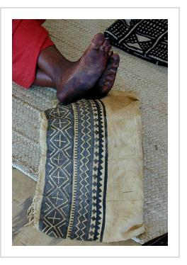Bogolan cloth in process. Design hand-drawn with iron-rich mud on strip-woven cotton fabric by Nakunte Diarra.