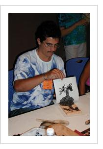 Ivan Borges demonstrates printing at the International Folk Art market in Santa Fe, July, 2005 (Photo by A H Fisher)