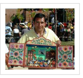 Claudio Jimenez Quispe with his Casa de los Gatos retablo in Santa Fe. July 2005
