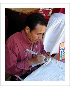 Claudio Jimenez Quispe at work at International Folk Art Market Santa Fe, NM, July 2004