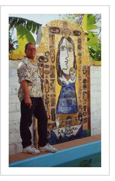 José Fuster with a tile mural of La Virgen de la Caridad, patron saint of Cuba, at his Havana studio. February, 2000