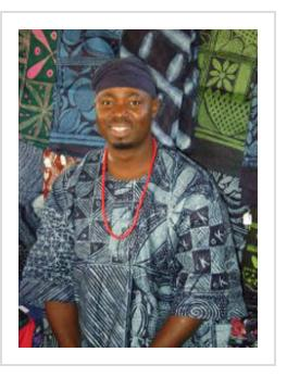 Nigerian indigo artist Gasali Adeyemo. Yoruba adire cloth shown. Santa Fe, NM, 2009. (photo courtesy of the artist).