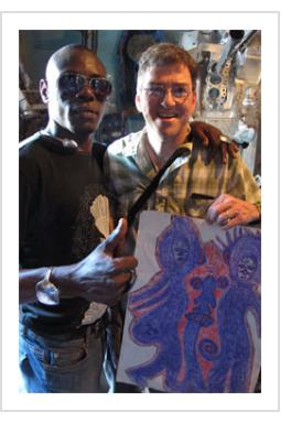 """Guyodo with tourist and '""""Marassa"""" drawing. (Photograph © Anthony Hart Fisher 2014)."""