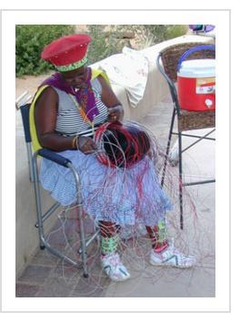 """South African Imbenge basket artist Jaheni Mkhize demonstrates """"soft basket"""" construction in Santa Fe, July 2005."""