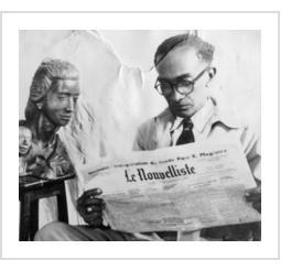 André V. Dimanche et une de ses sculptures lisant Le Nouvelliste, courtoisie de Marie Michelle Dimanche - See more at: http://www.lenouvelliste.com/article/170610/la-sculpture-en-haiti-au-xxe-siecle-andre-v-dimanche-sculpteur-intuitif#sthash.2CWGgKV5.dpuf