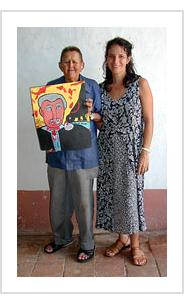 Abel Perez Mainegra (with daughter) and painting of George Bush. Trinidad, November, 2003.