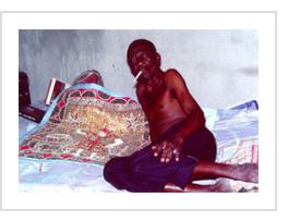 Silva Joseph in his houmfor. Belair, Port-au-Prince, Haiti, 1991 (photograph by Anthony Fisher)