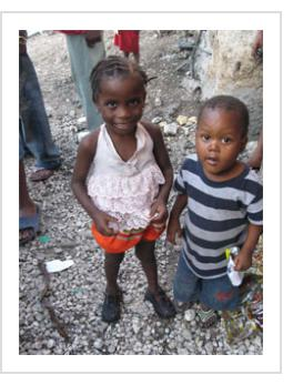 """Timoun"". Two of the children of the Gran Rue, November, 2009. (Photograph © Anthony Hart Fisher 2009)."