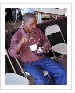 "South African Imbenge basket artist Vincent Sithole demonstrates his art on a ""hardwire basket"" at the International Folk Art Market in Santa Fe, NM, July 2004."