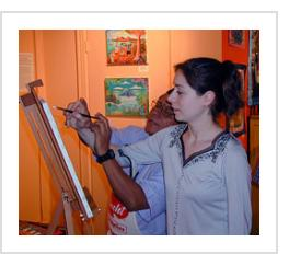 Ignacio Fletes Cruz instructs a visitor to Indigo Arts. March 6th, 2004