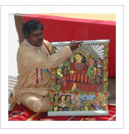 Bengali artist Gurupada Chitrakar sings the story of September 11th, 2001, in Santa Fe, July, 2006 (Photograph © Anthony Hart Fisher 2006).