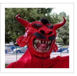 Papier Maché devil mask from Jacmel, Haiti ( devil mask #hmsk-07, below), at the Smithsonian Folklife Festival in Washington DC, July, 2004. ( Photograph © Anthony Hart Fisher 2004).