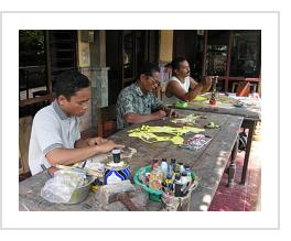 Tri Suwarno and family work together to make wayang kulit (Photograph by Felicia Katz-Harris - Sewn, Bantul, Java, Indonesia, 2007).