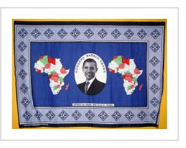 "Hongera Barack Obama khanga cloth from Tanzania on display at the Smithsonian National Museum of African Art. Swahili translates ""Congratulations Barack Obama"". Phrase below is ""Upendo na Amani Tujalia Mungu"" (""God Has Blessed Us With Peace And Love"" )."