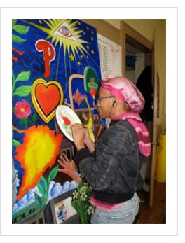 Precious working on a detail of the mural at Centro de Estudiantes, April 10 2011.