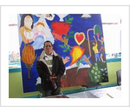 Ignacio Fletes Cruz with mural in progress at Centro de Estudiantes, April 10 2011.