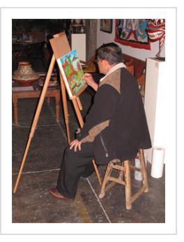 """Ignacio Fletes Cruz painting """"Camino al Rio"""" at Indigo Arts, April 9 2011."""