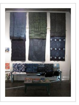 Indigo at Indigo exhibit shown at opening, featuring indigo-dyed Yoruba adire eleko, adire alabere and adire oniko fabrics. March, 2012. (Photograph © Anthony Hart Fisher 2012)