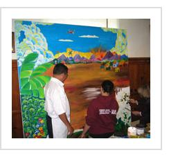Ignacio Fletes Cruz at work on the mural at Gettysburg Lutheran Seminary. February, 2004