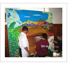 Ignacio Fletes Cruz at work on the mural at Gettysburg Lutheran Seminary. February, 2004