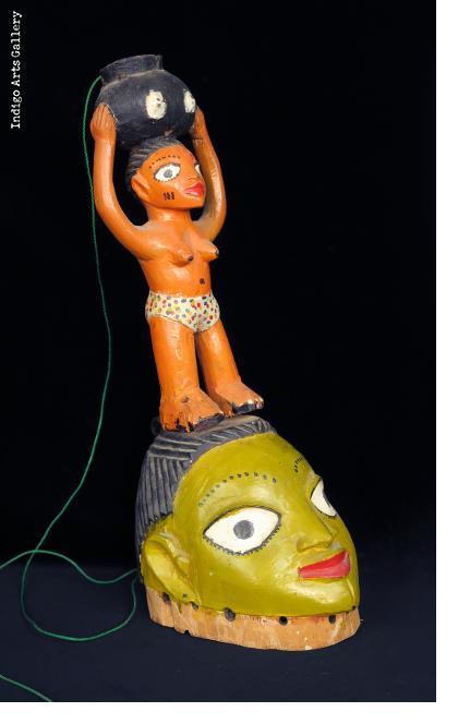 Fon Gelede Mask Surmounted by Snake in Jar