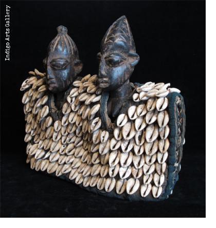 Ibeji Twin Figures with cowrie jacket