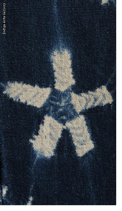Indigo stitch-resist-dyed strip-weave cotton cloth