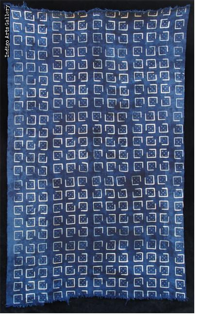 Indigo resist-dyed strip-weave cloth