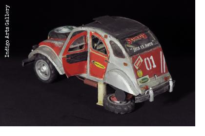 Red Citroen Deux Chevaux with a flat tire
