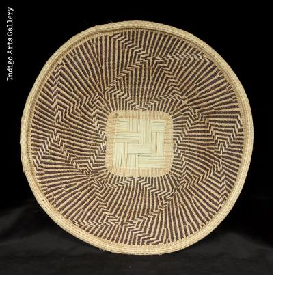 "Nambya BasketNambya People, Zimbabwe. Illala palm, grasses and split bamboo with natural plant dyes. (14""diam. x 3 1/2"" h.)"